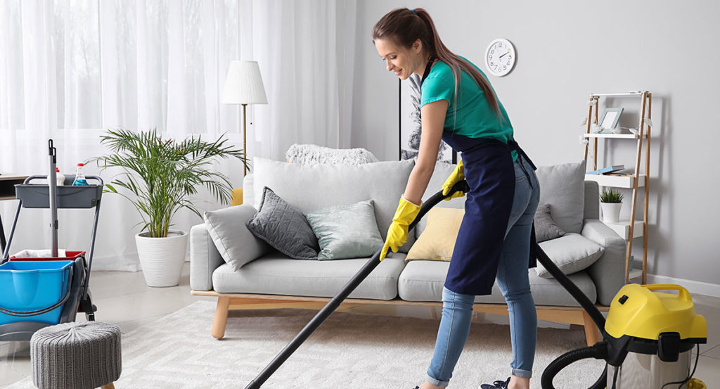Maid cleaning living room during a move in clean